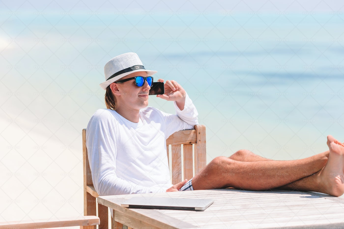 Taking A Call During Vacation: Stock Photos