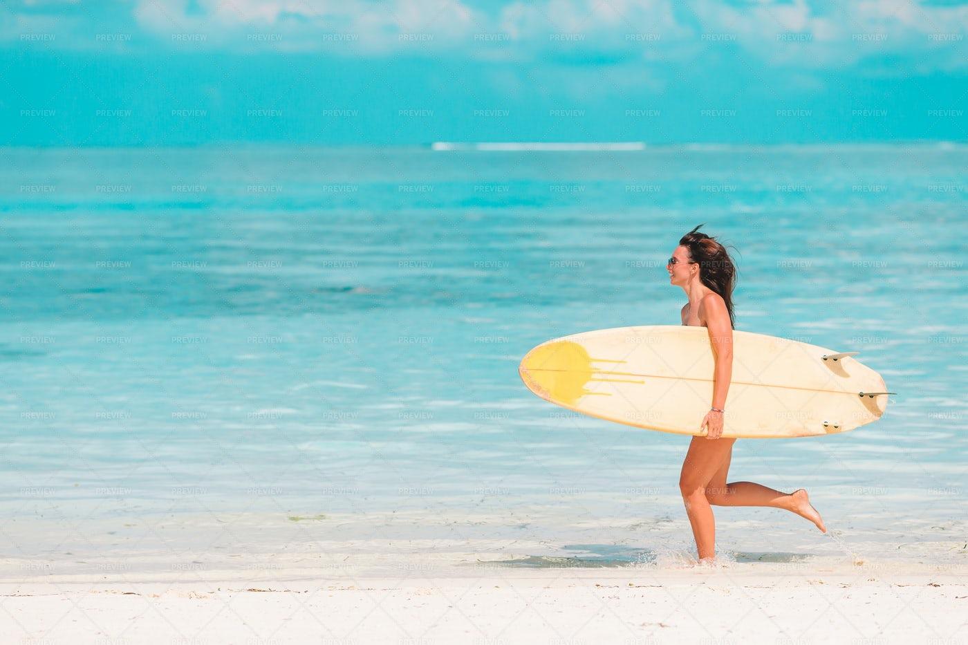 Running Surfer: Stock Photos
