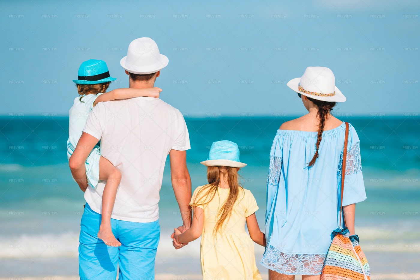 Family Hold Hands On Shore: Stock Photos