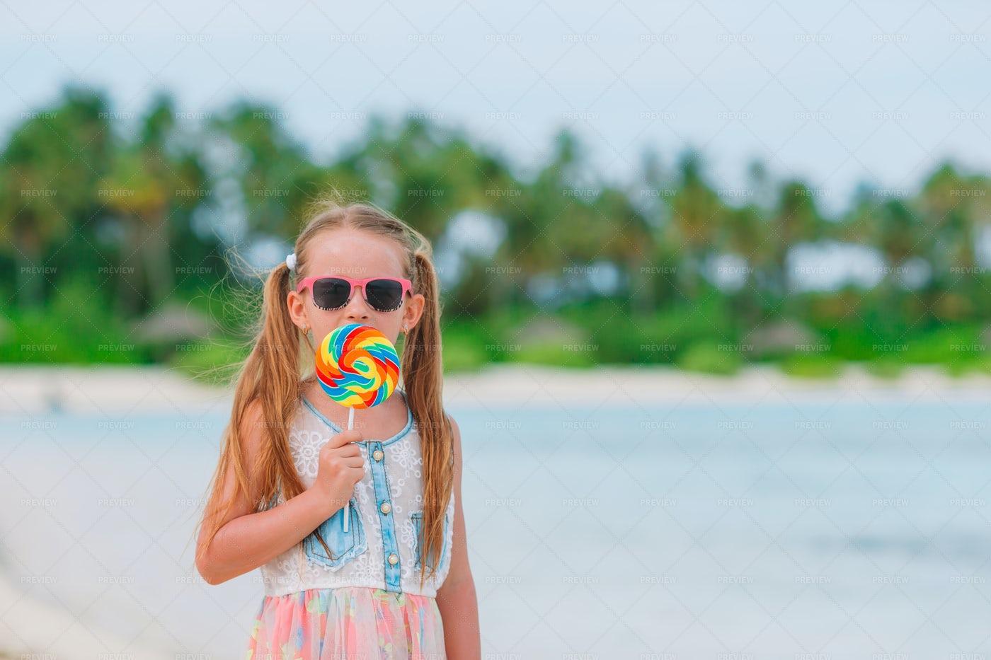 Girl With Lollipop On Beach: Stock Photos
