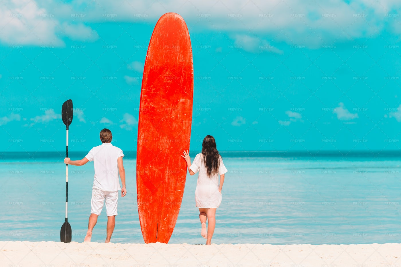 Couple With Red Paddlboard: Stock Photos