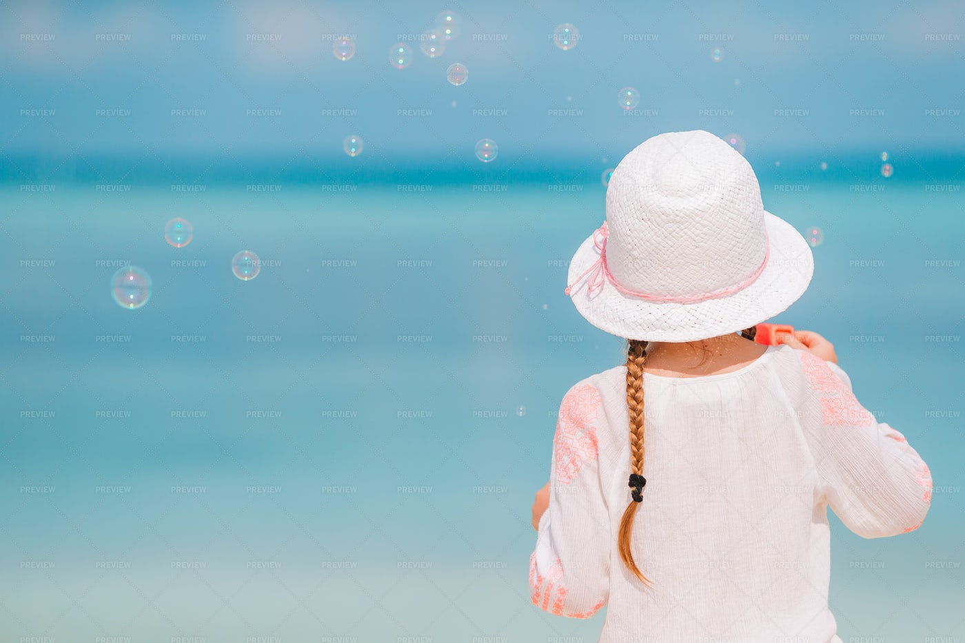 Blowing Bubbles On Beach: Stock Photos