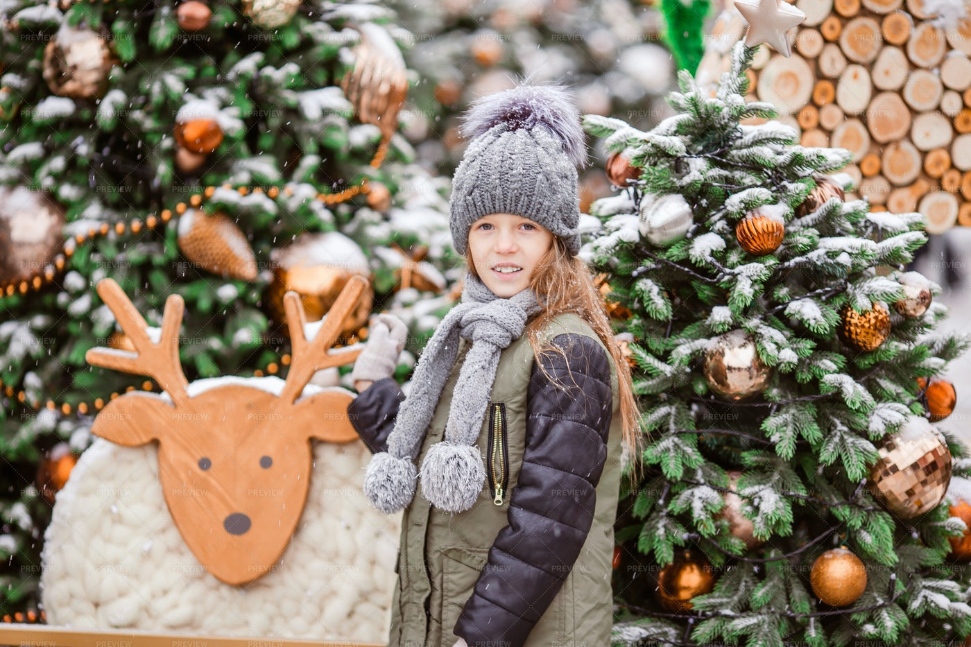 Child Beside Christmas Decorations: Stock Photos