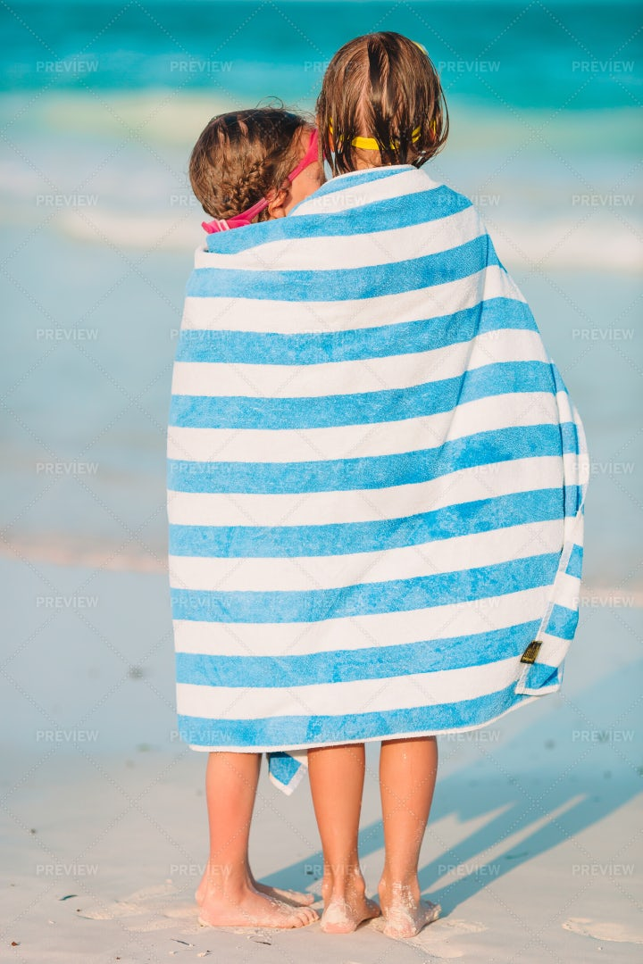 Sisters Wrapped Up In Large Towel: Stock Photos