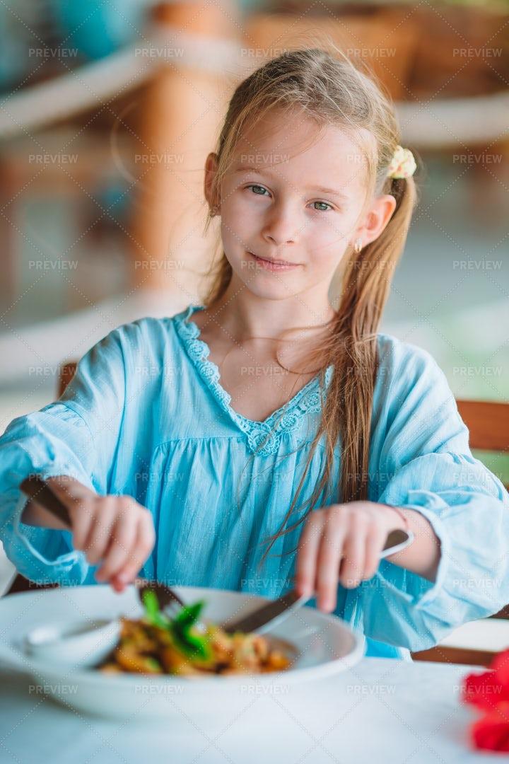 Kid Eating Bowl Of Pasta: Stock Photos