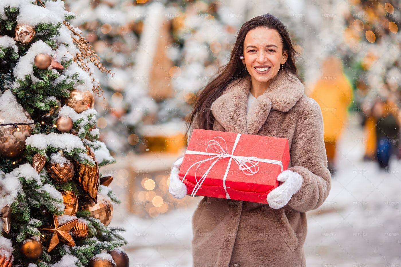 Holding A Christmas Gift: Stock Photos