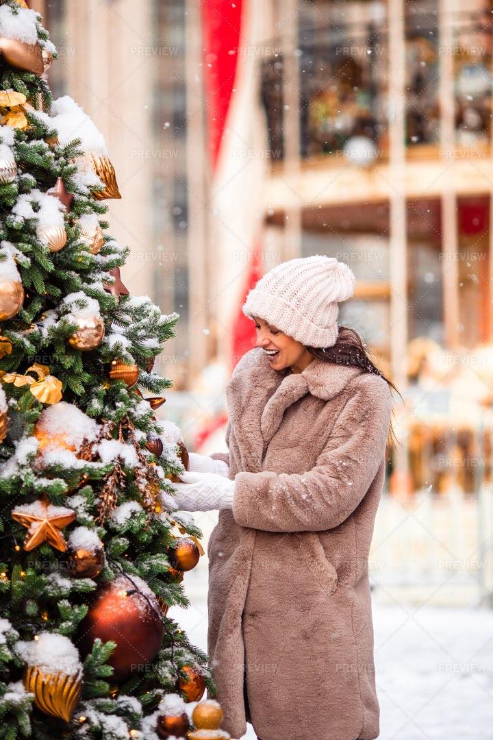 Looking At Tree Ornaments: Stock Photos