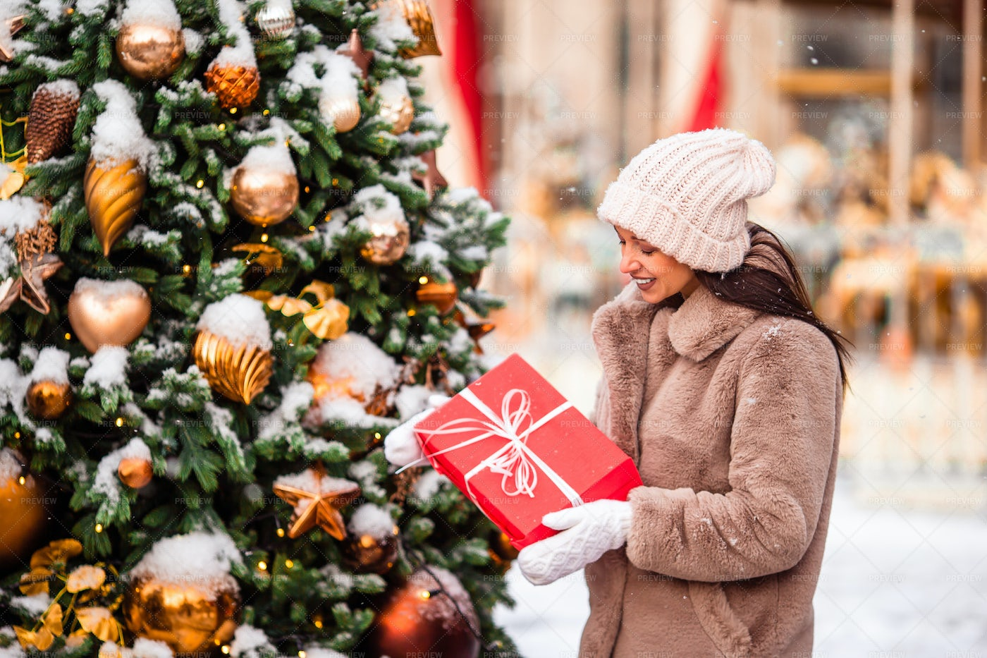 Putting Charity Gift Under Tree: Stock Photos