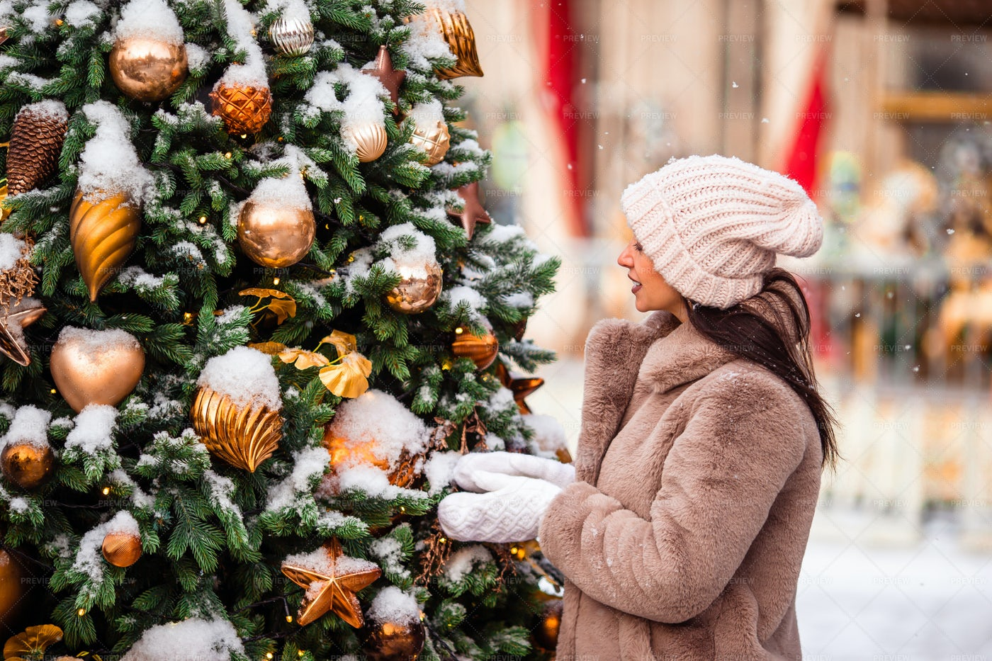 Admiring Christmas Decorations: Stock Photos