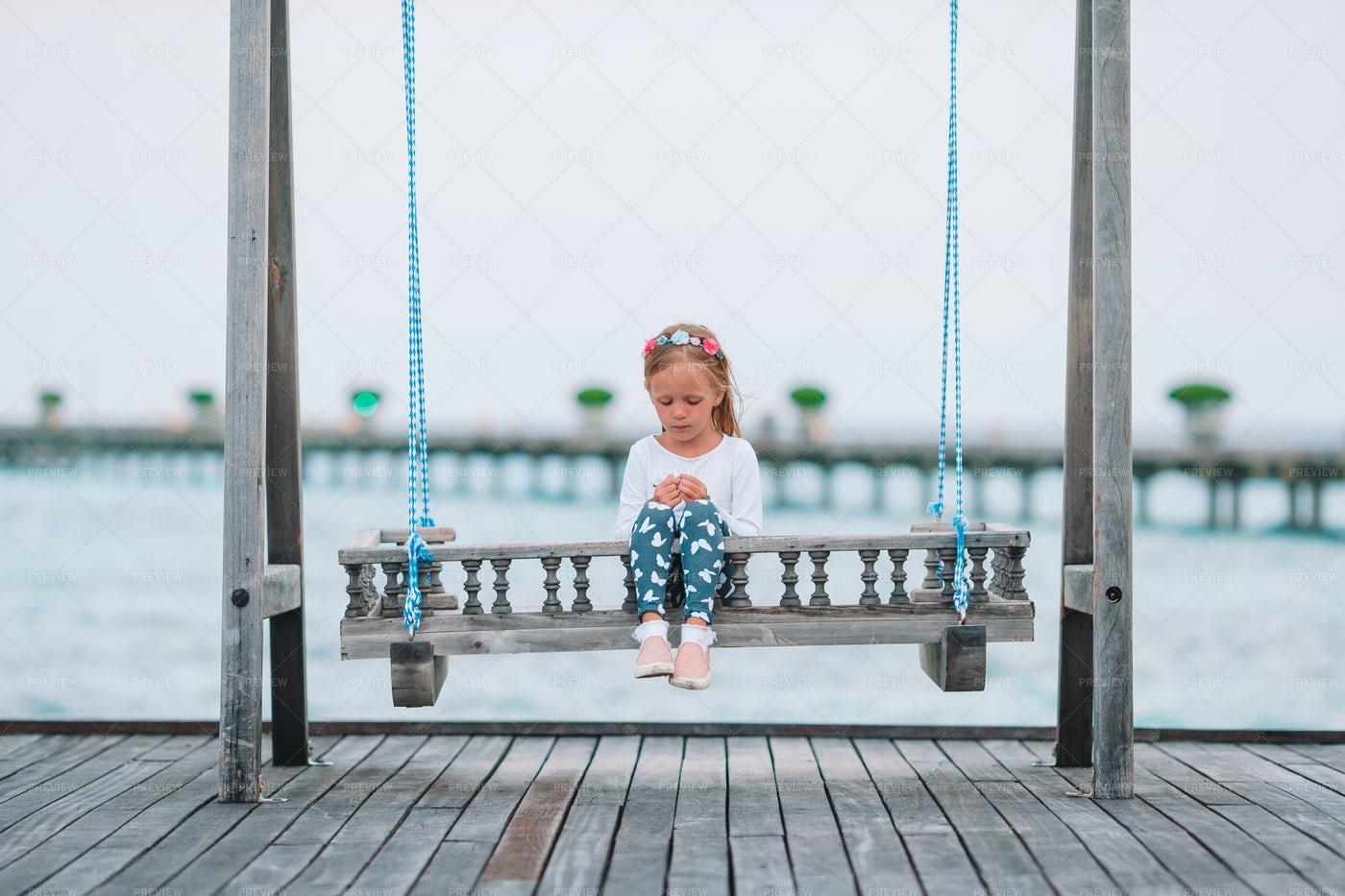 Girl On Wooden Swing: Stock Photos