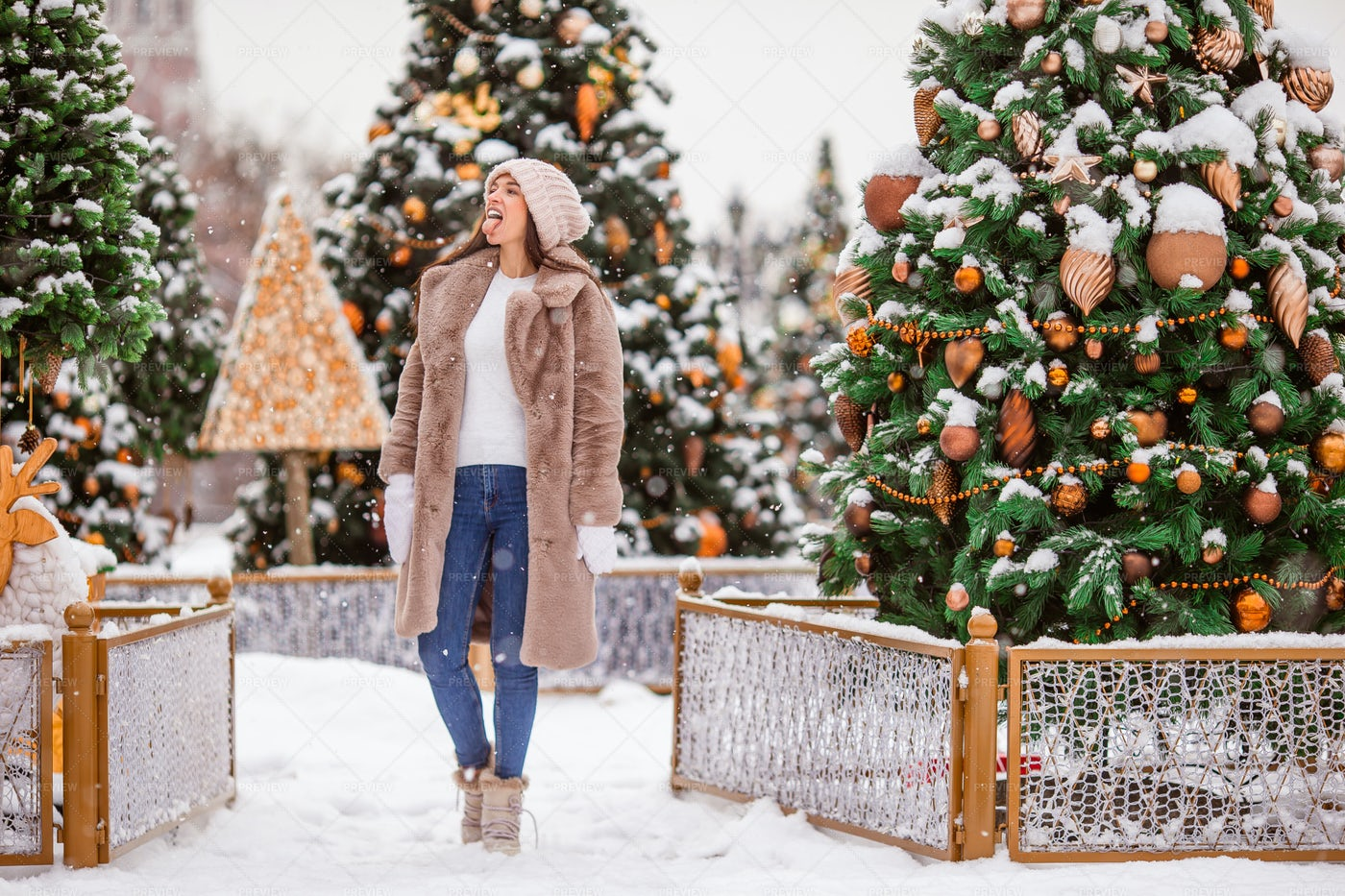 Catching Snowflakes On Tongue: Stock Photos
