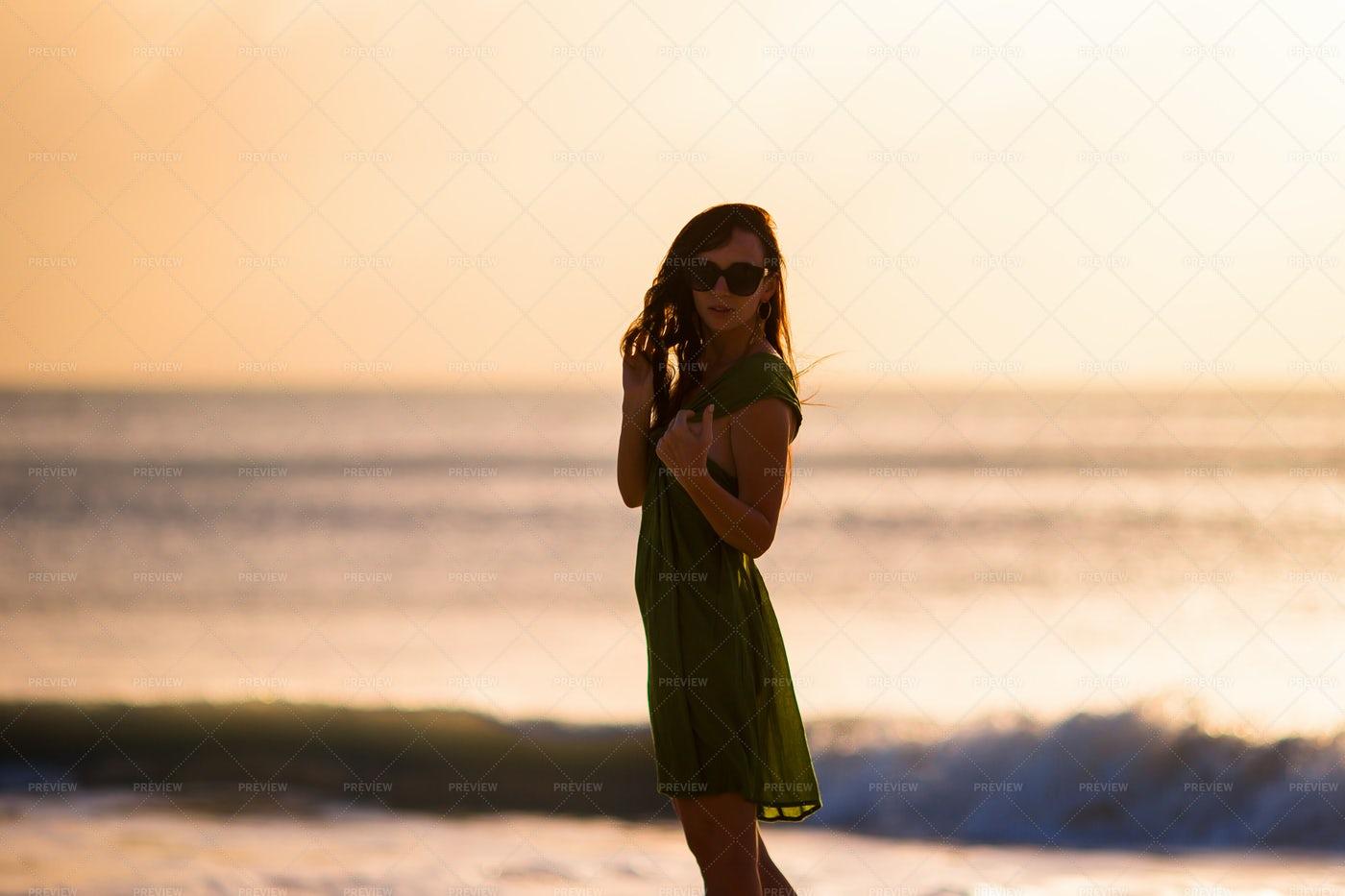 Woman At Sunset: Stock Photos
