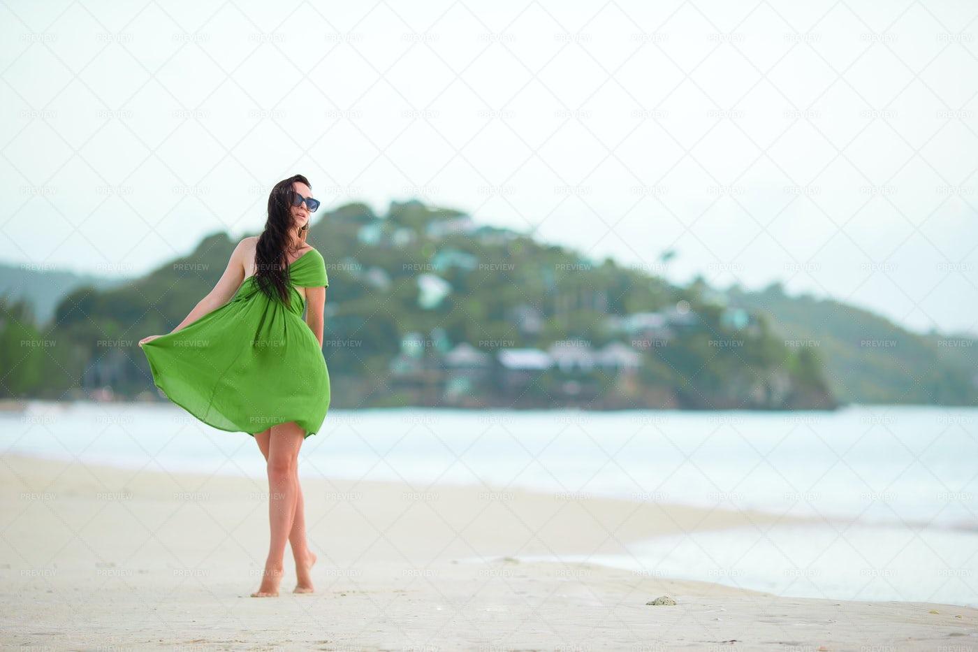 Woman In Green Dress On Beach: Stock Photos