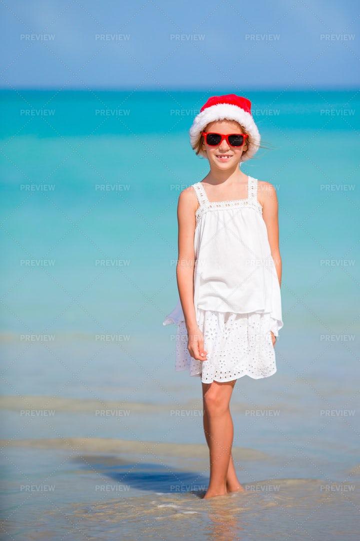 Child In Santa Hat On Beach: Stock Photos
