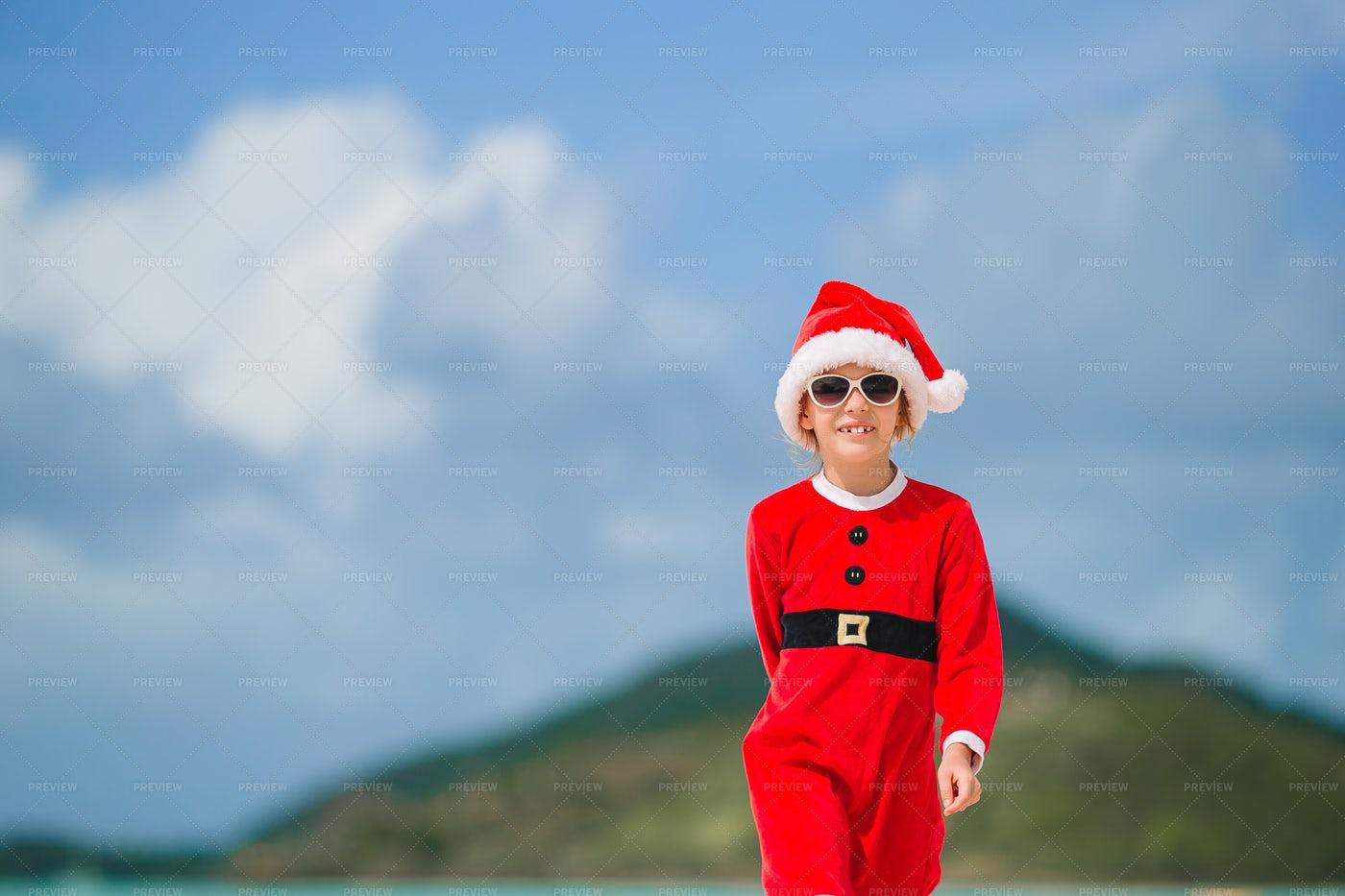 Little Santa On Tropical Island: Stock Photos