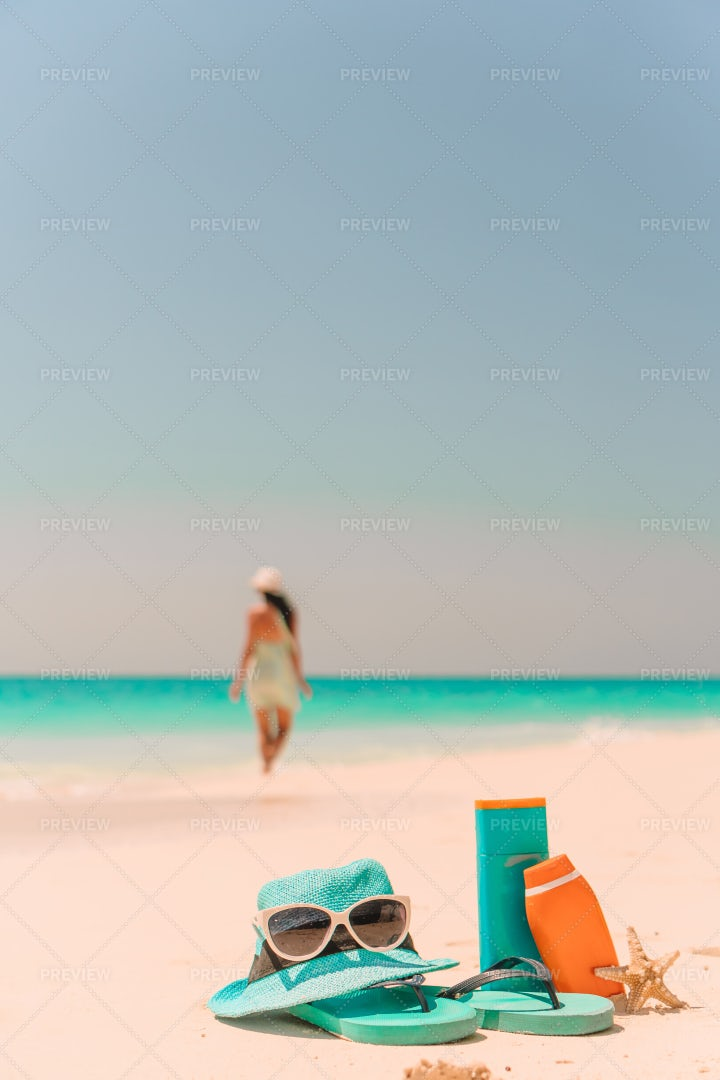 Woman Leaves Beach Accessories: Stock Photos