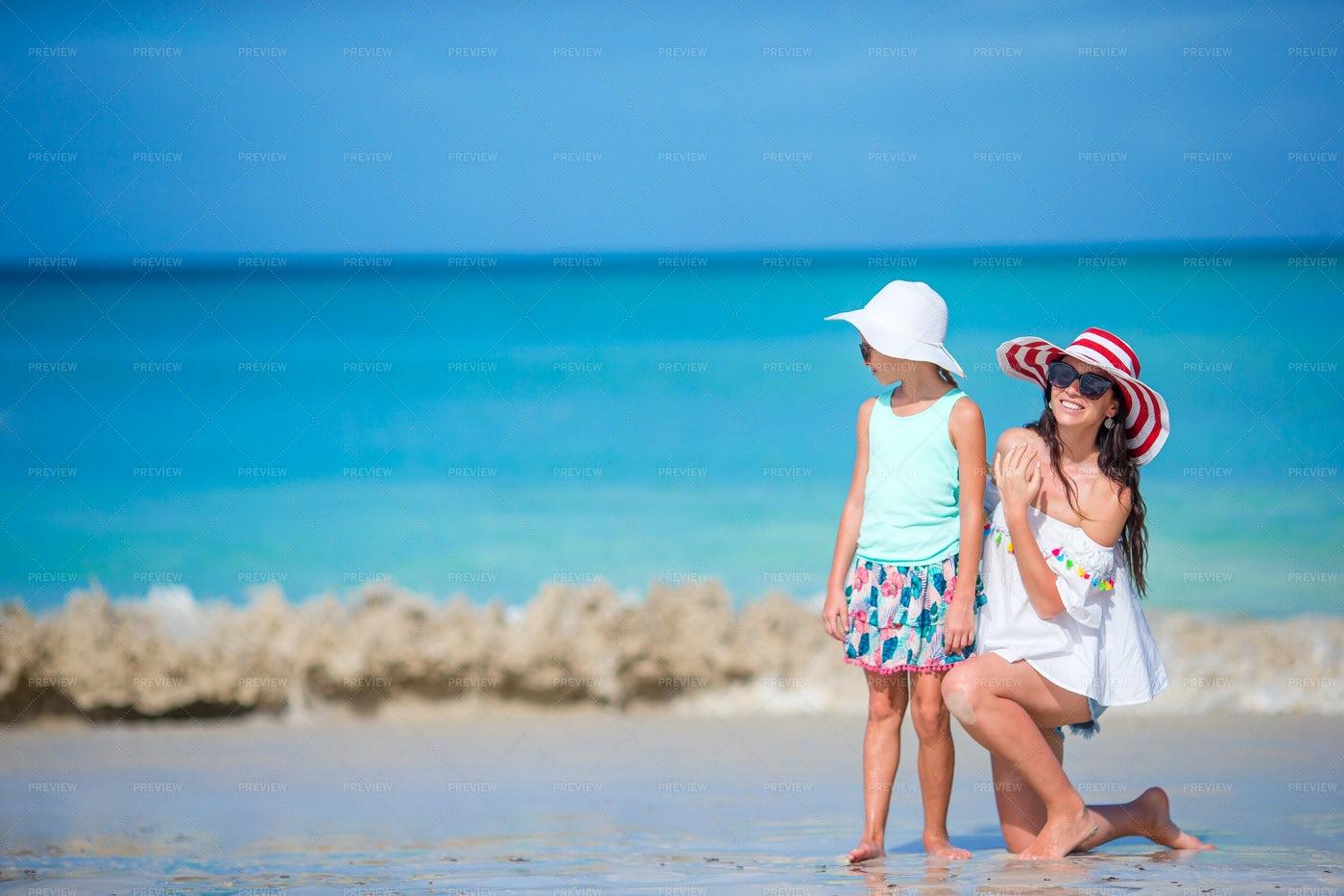 Mom And Girl On The Beach: Stock Photos
