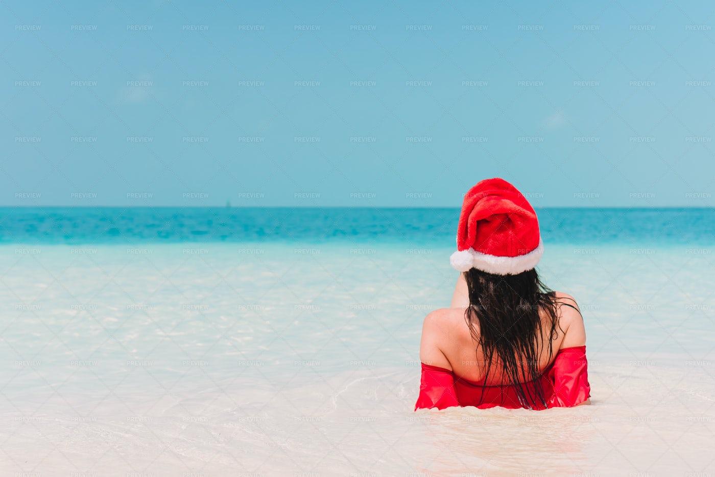 Wearing Santa Hat On Vacation: Stock Photos