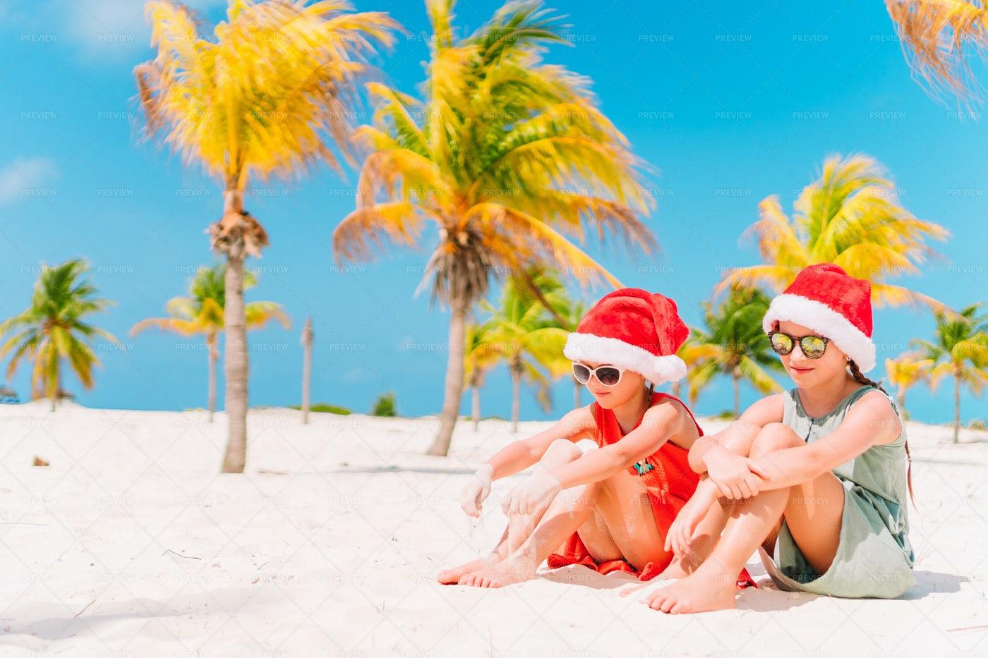 Santa Girls On The Beach: Stock Photos