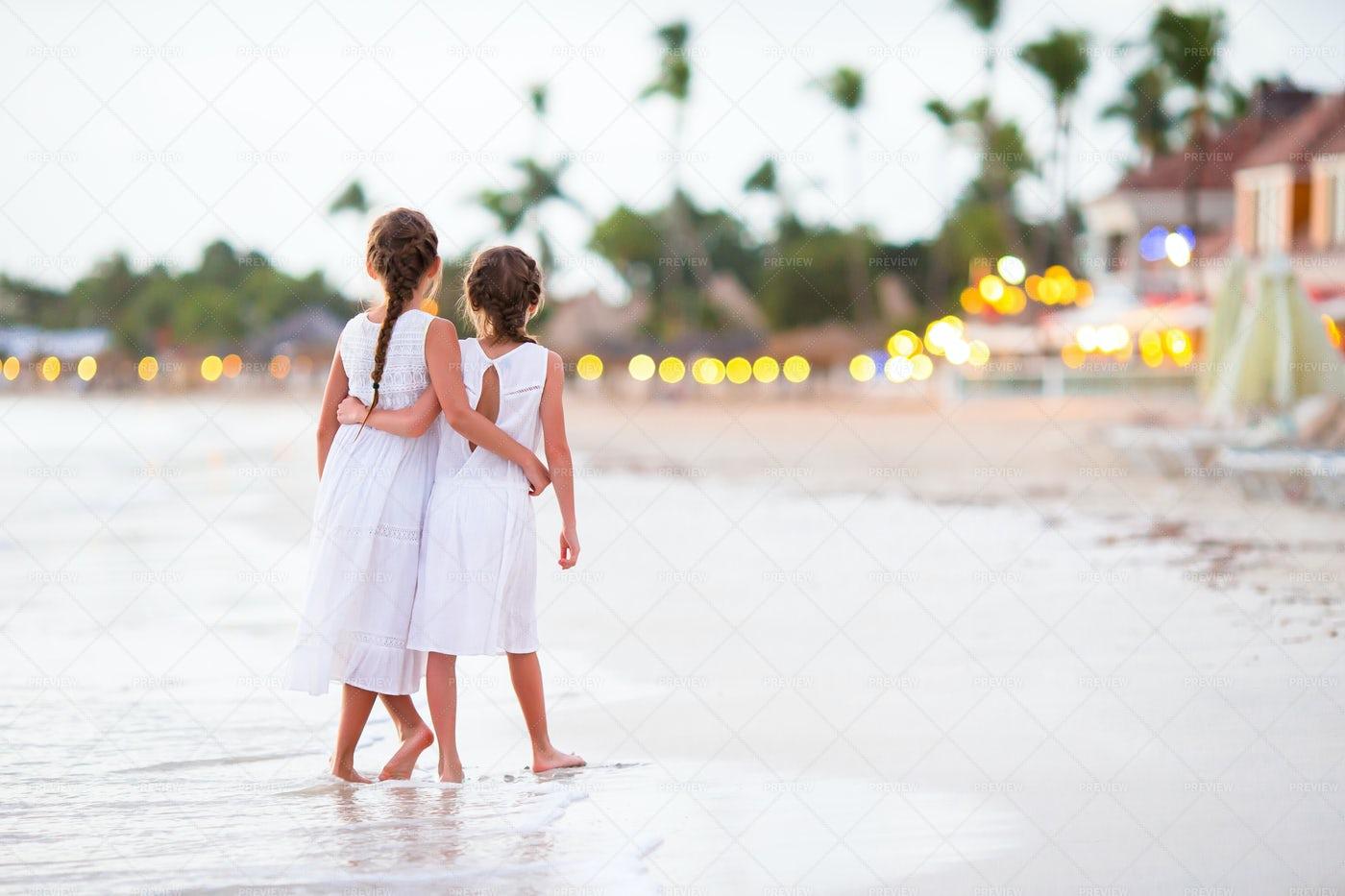Sisters Hug On Tropical Beach: Stock Photos