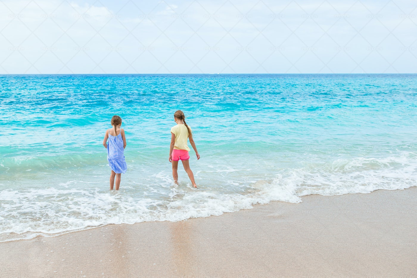 Friends Stand In Shallow Water: Stock Photos
