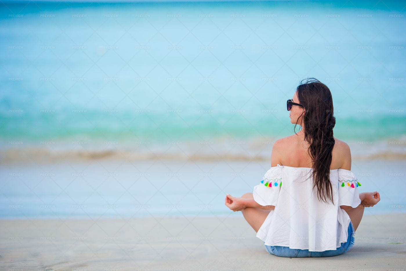 Meditating On Ocean Shore: Stock Photos