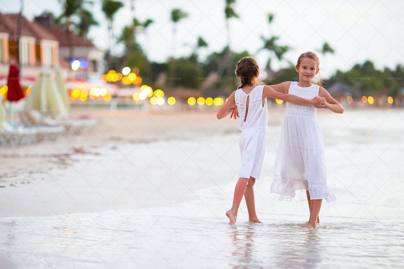 Children Dancing On A Beach: Stock Photos