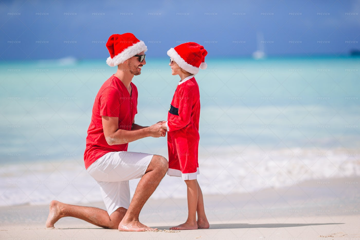 Father And Daughter In Santa Costume: Stock Photos