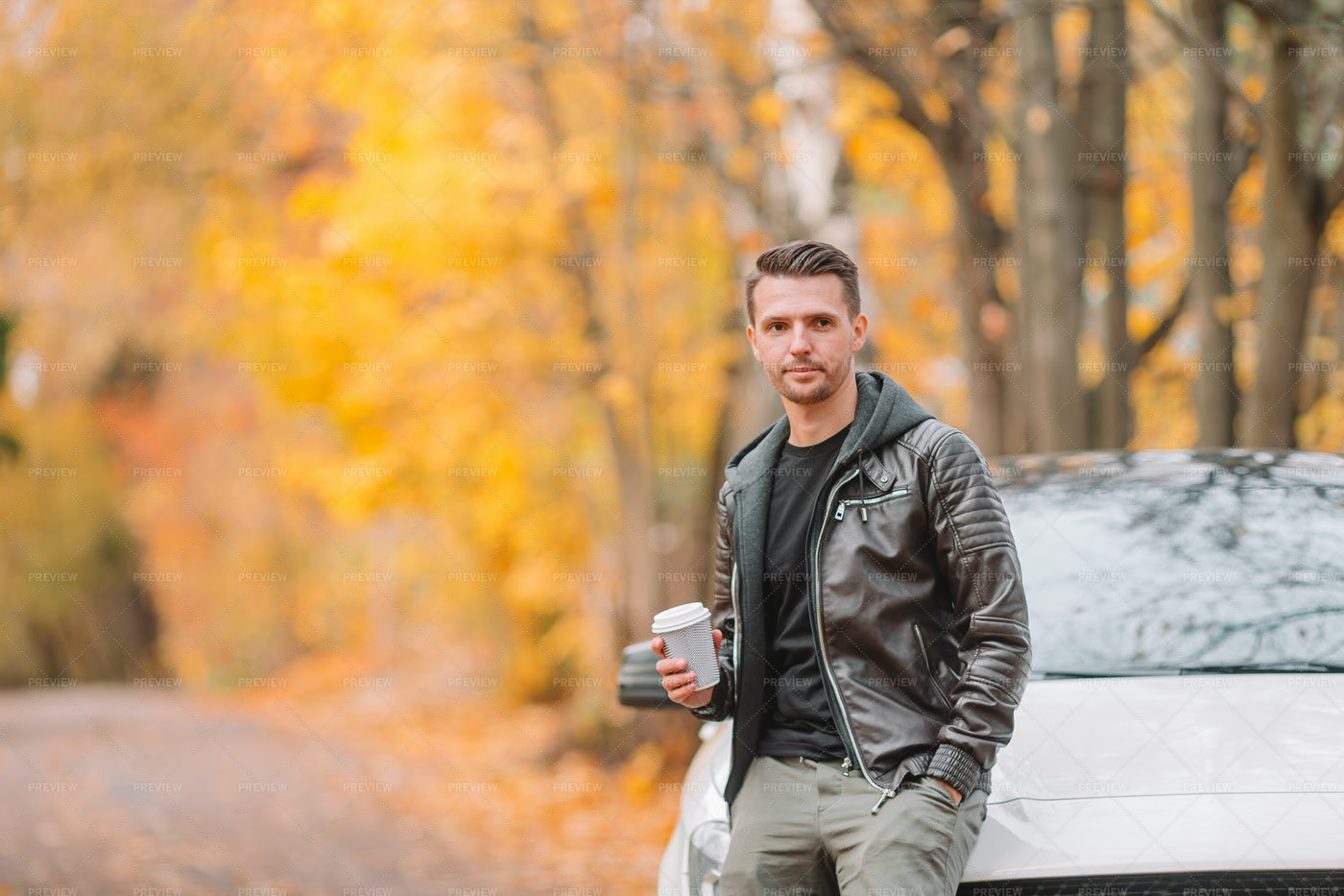 Leaning Against Car With Coffee: Stock Photos