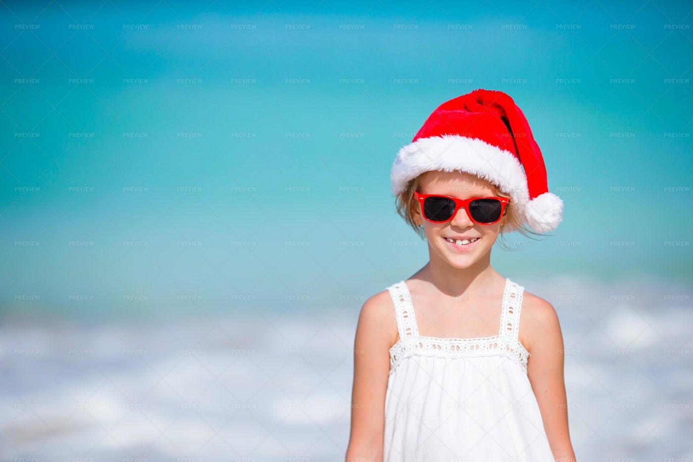 Girl In Santa Hat On Beach: Stock Photos
