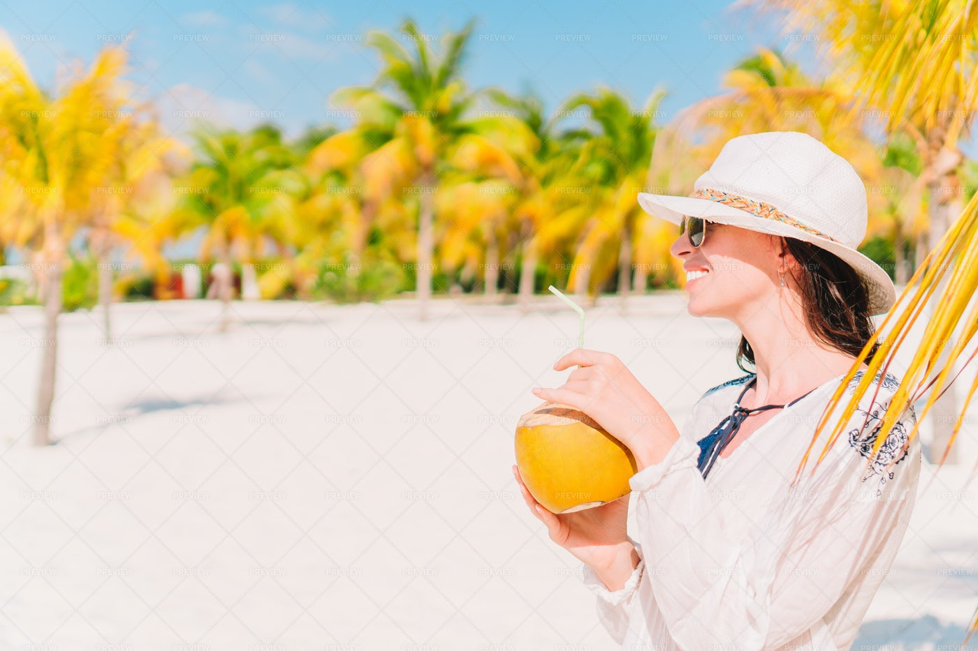 Woman Drinking Coconut Water: Stock Photos