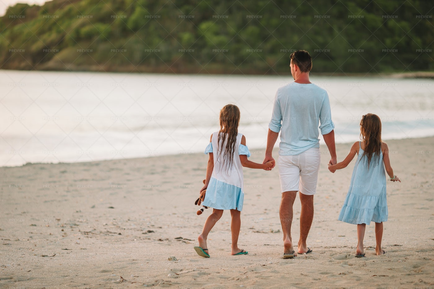 Father And Daughter Walking On The Beach: Stock Photos