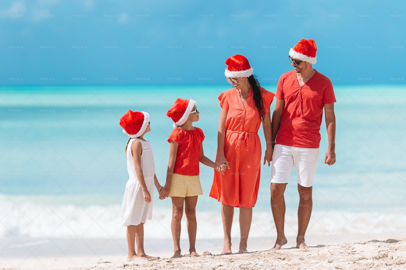 Family With Two Kids In Santa Hat: Stock Photos