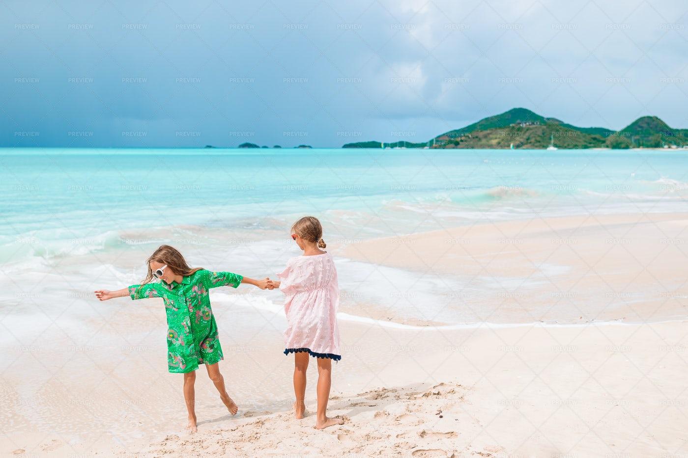 Girls Playing Around On A Beach: Stock Photos