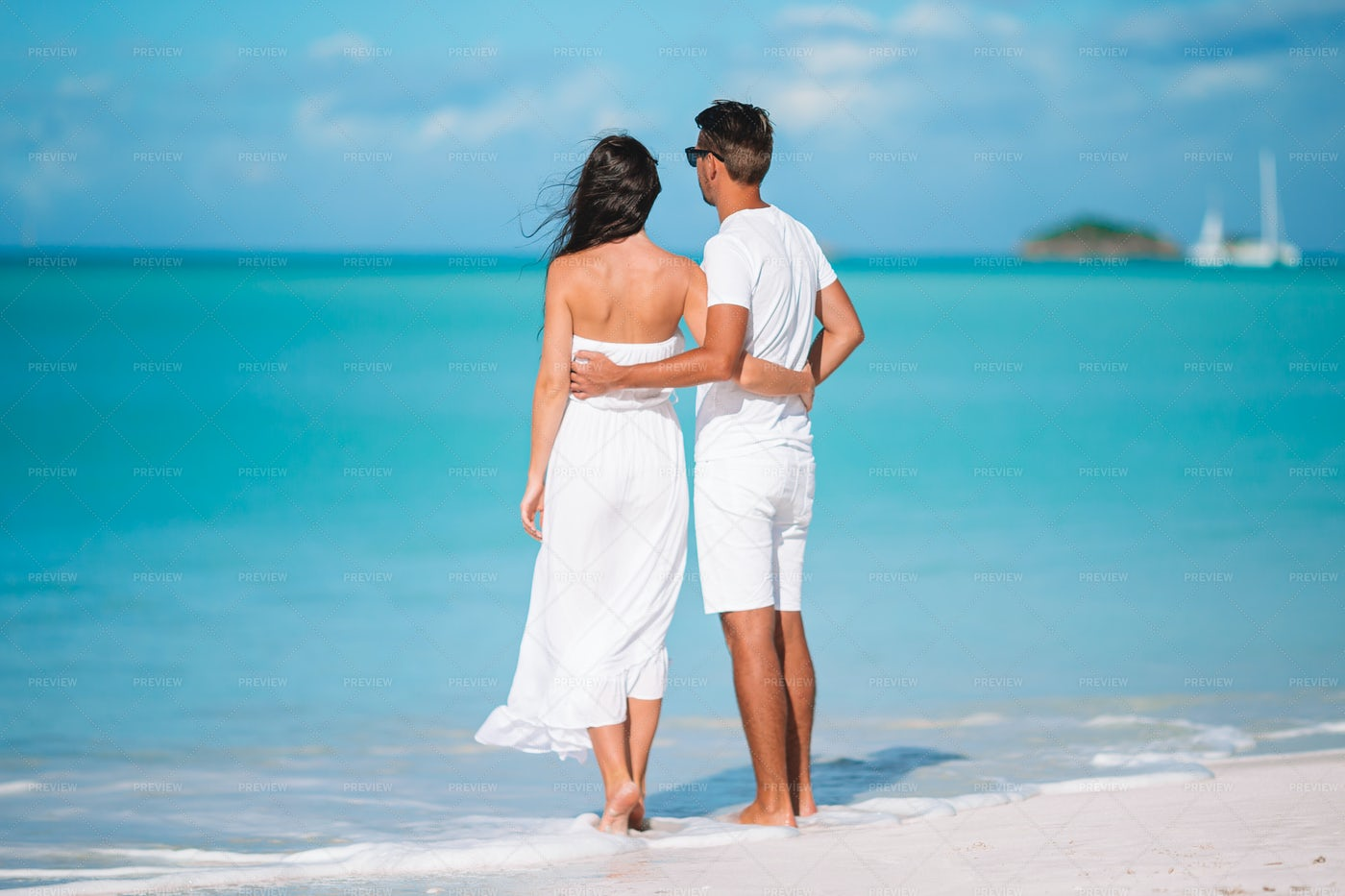 Couple Stand By The Shore: Stock Photos