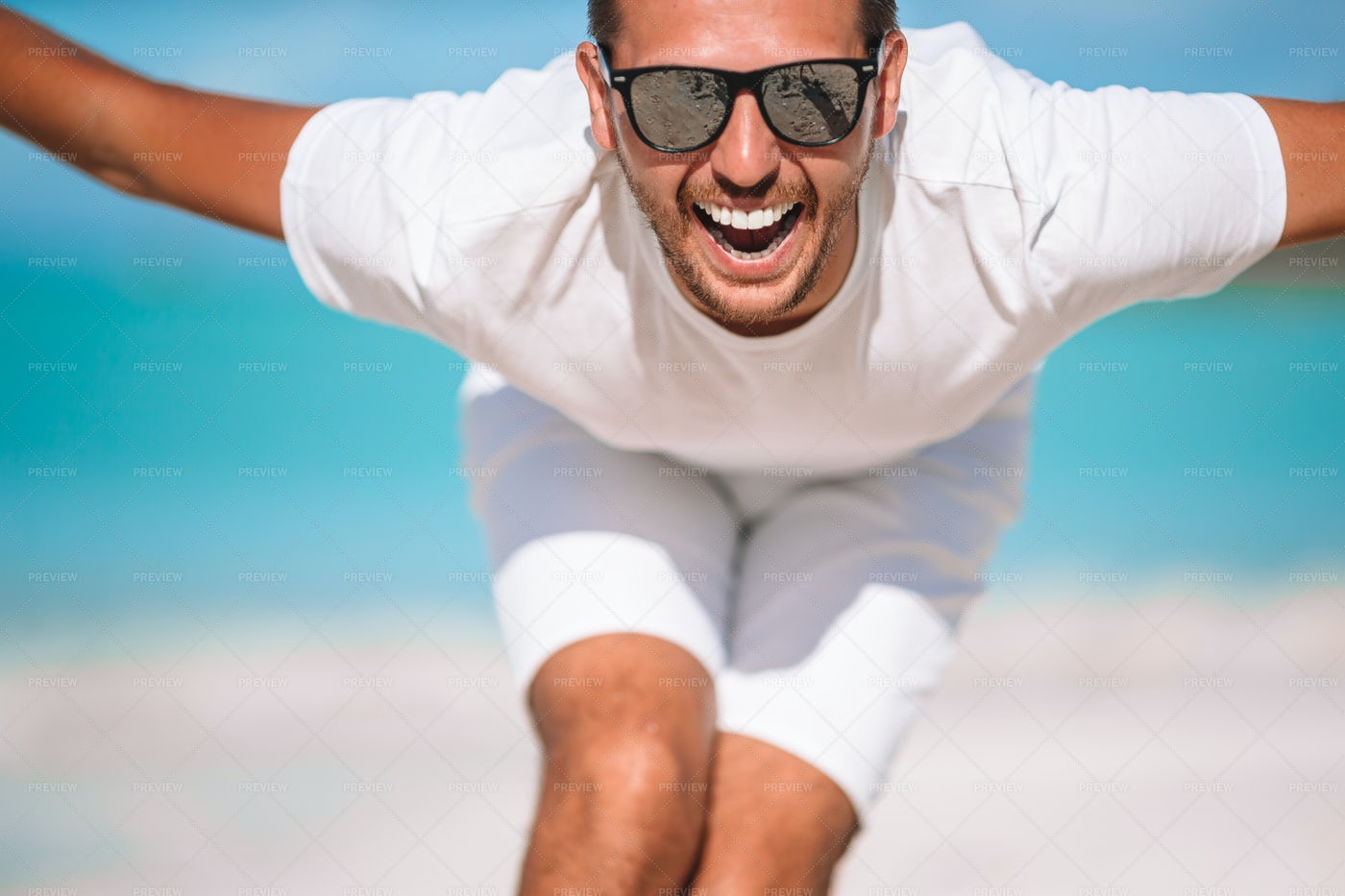 Man Jumping On Beach: Stock Photos