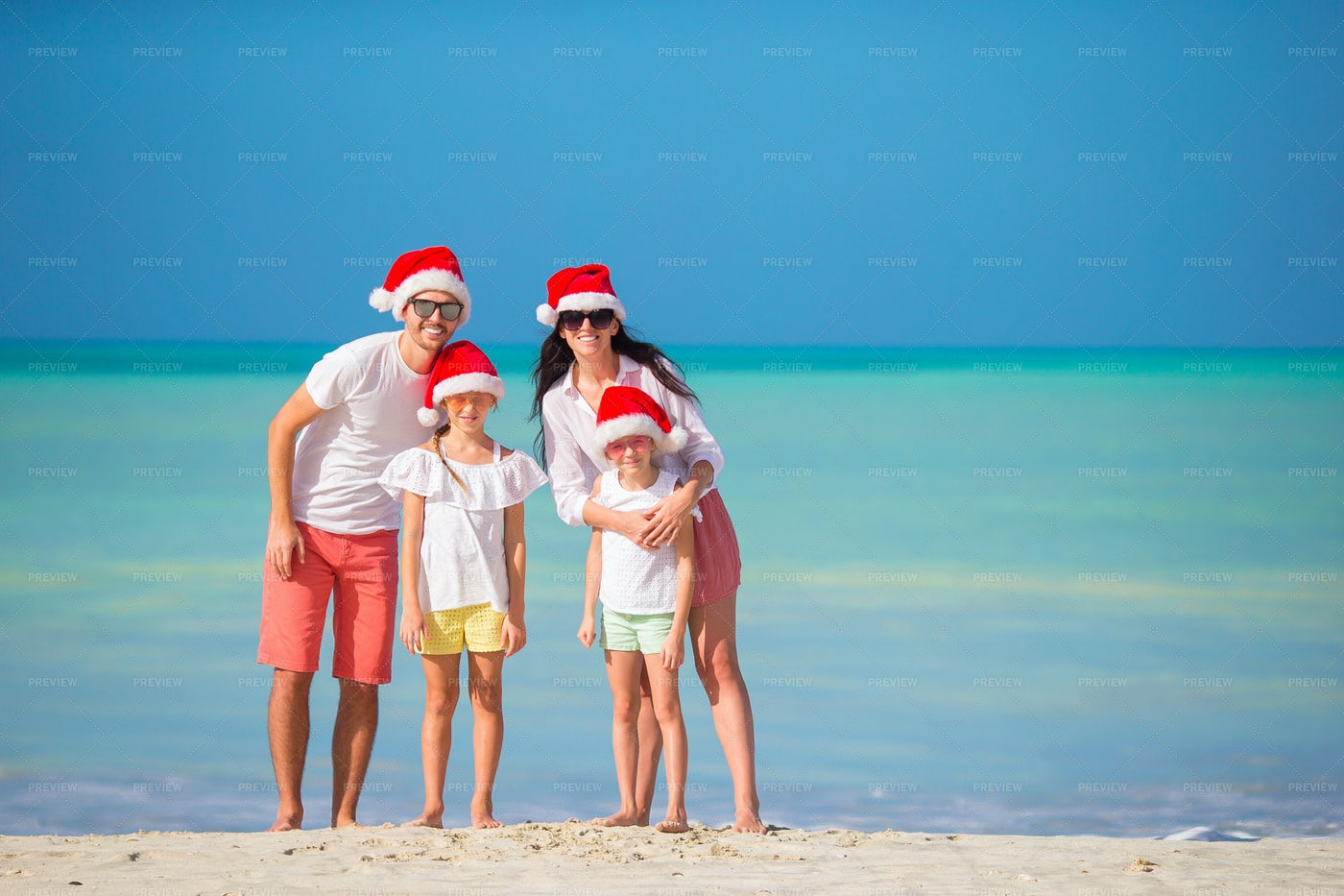 Coastal Family Celebrates Christmas: Stock Photos