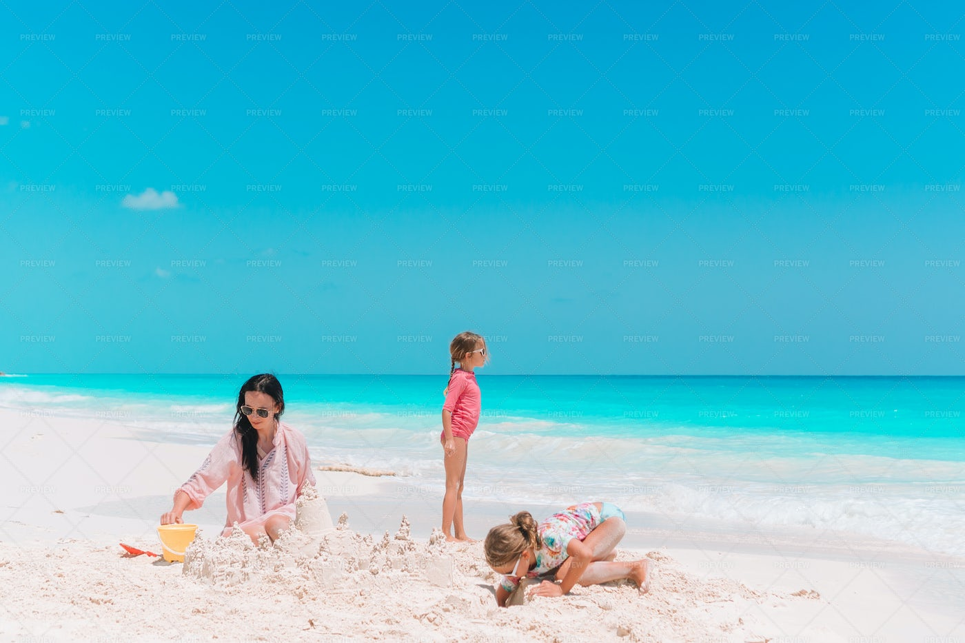 Family Making A Sand Castle: Stock Photos