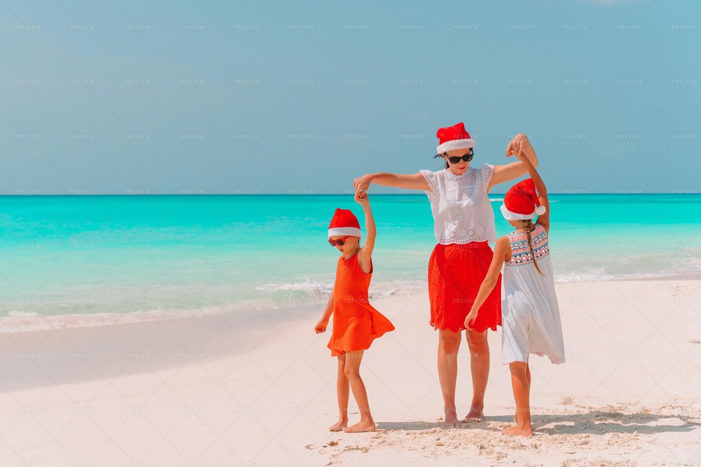Dancing On Beach With Santa Hats: Stock Photos