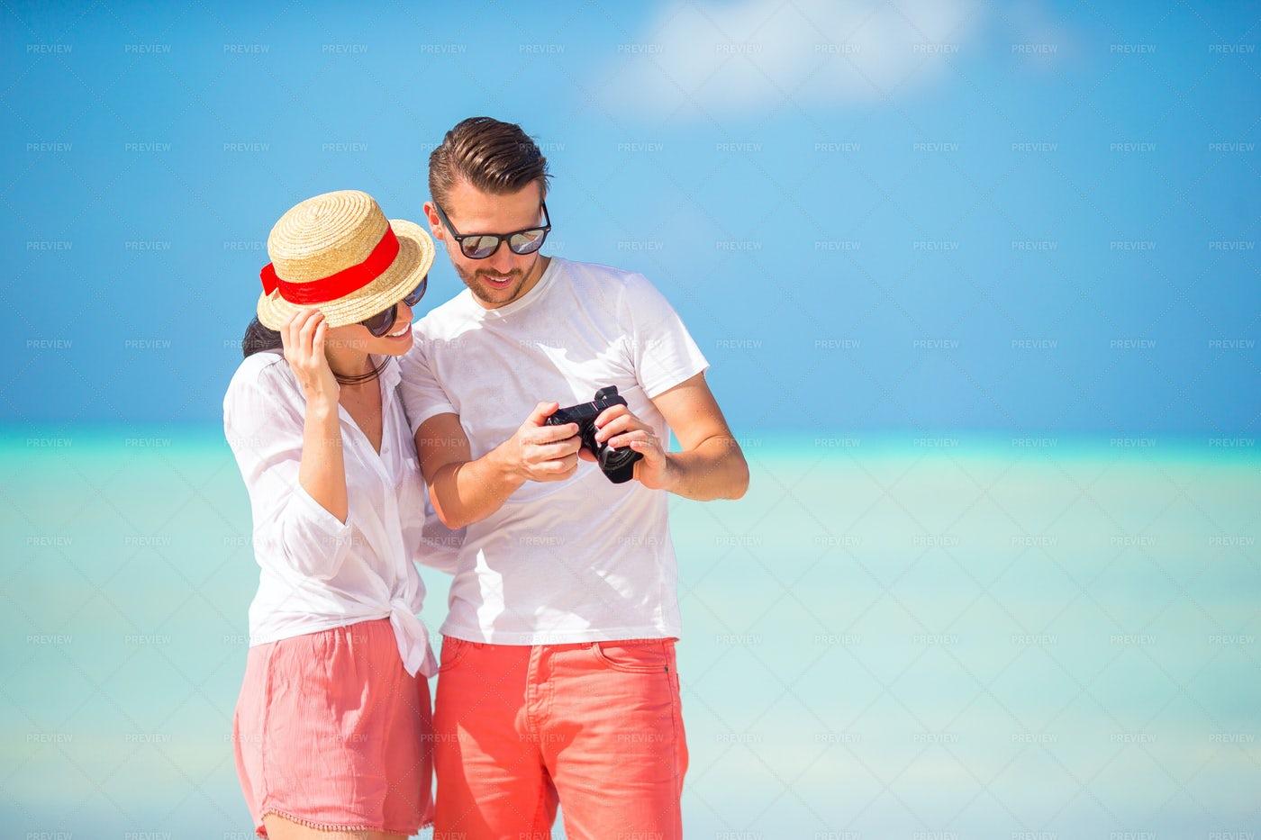 Reviewing Vacation Photos: Stock Photos