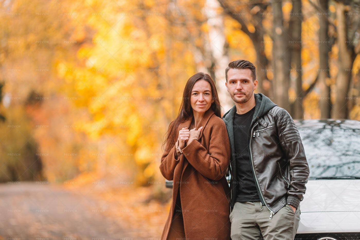 Couple Leaning On Car Hood: Stock Photos