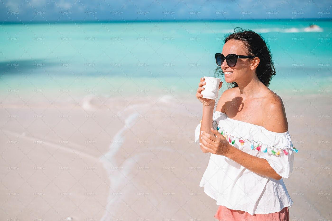 Having A Hot Drink At The Beach: Stock Photos