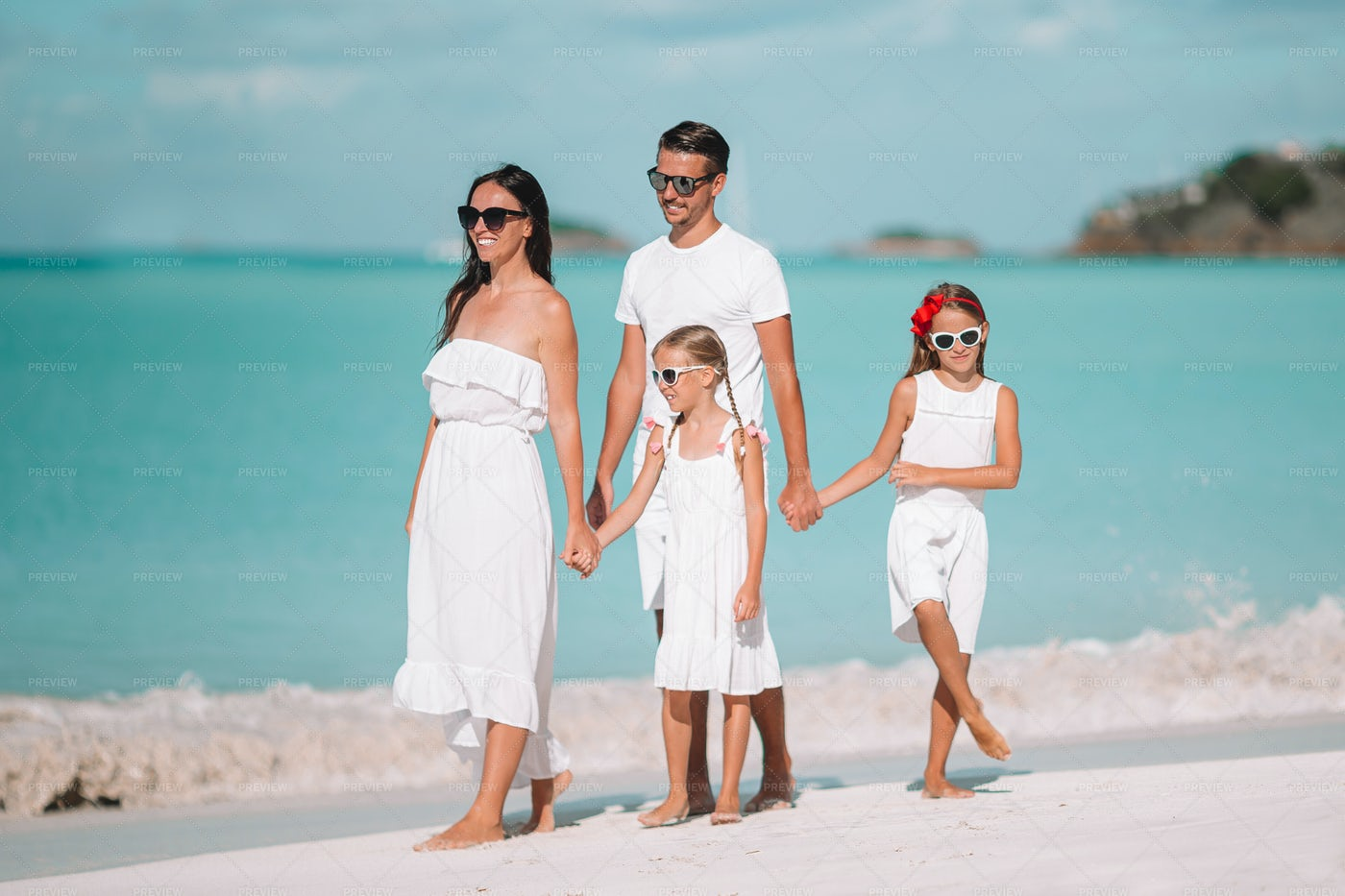 Family Holding Hands On Shore: Stock Photos