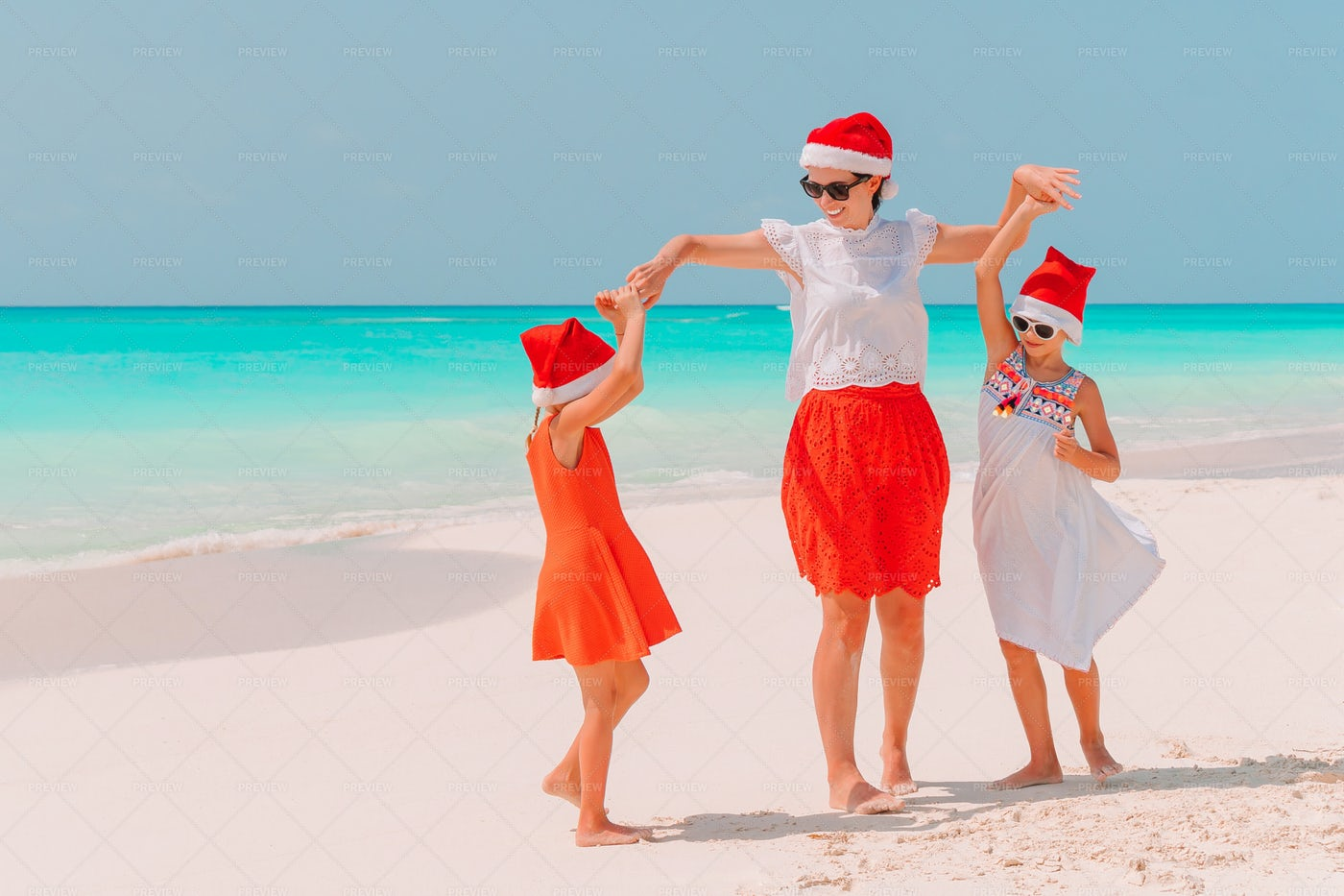 Twirling In Santa Hats: Stock Photos