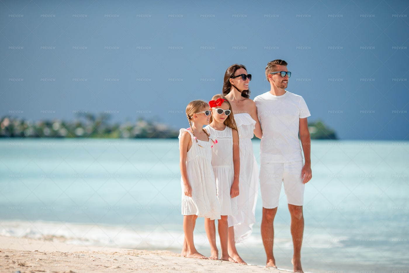 Vacationing Family In White: Stock Photos