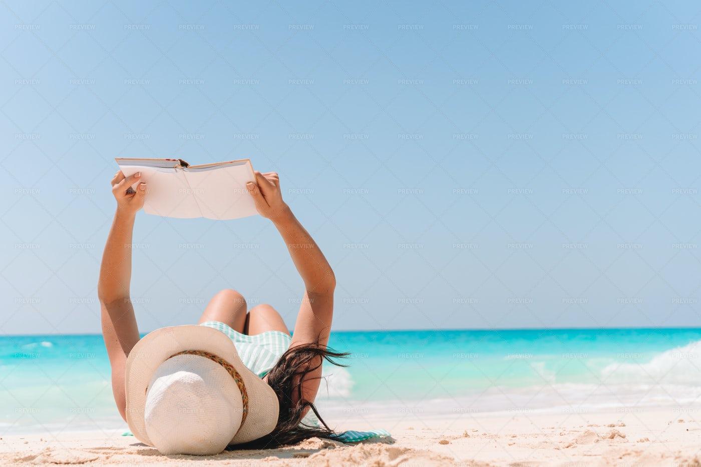 Reading On The Sandy Beach: Stock Photos