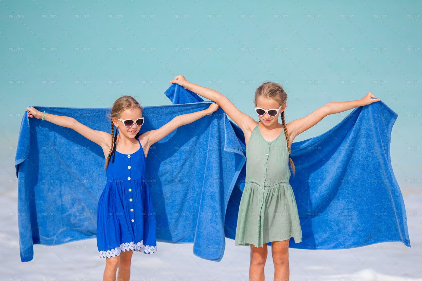 Playing With Beach Towels: Stock Photos
