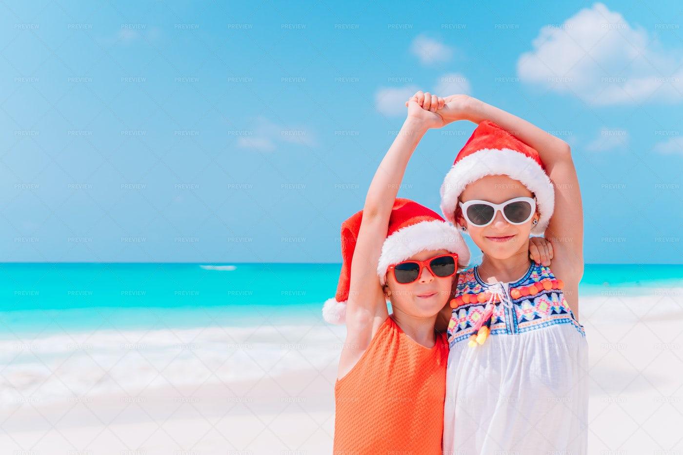 Wearing Santa Hats On The Beach: Stock Photos