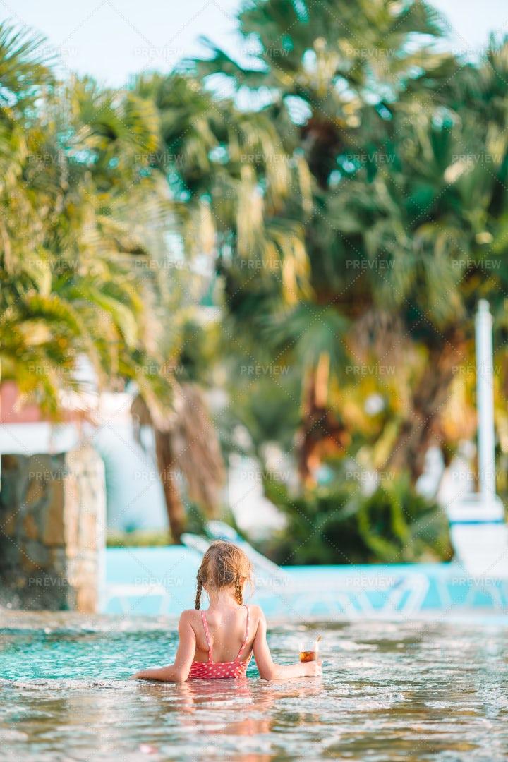Drinking Soda In Resort Pool: Stock Photos