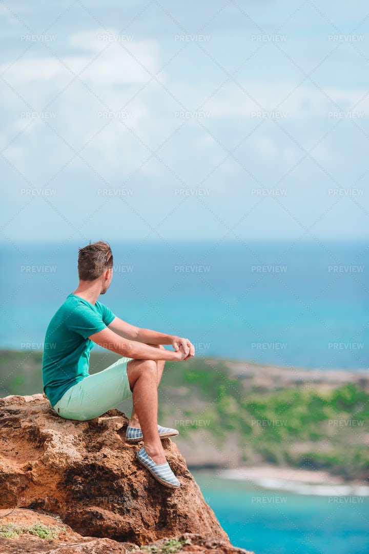 Man Sitting On Edge Of Cliff: Stock Photos